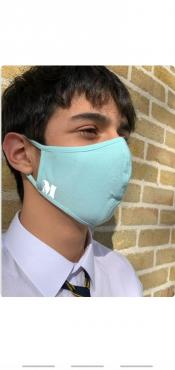 Light blue face-mask with patches that are available in black and white color